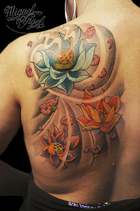 Lotus flowers and blossoms custom tattoo