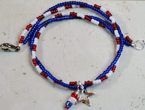 Stone Mountain Jewelry celebrates the fourth of July with you and brings you this fun red, white and blue double strand anklet.      It has a silver plated heart and red, white and blue beaded charm d