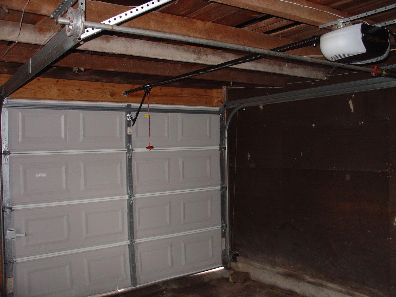 Installing Garage Door What To Keep In Mind Www Ramseal Com Garage Door Opener Installation Garage Door Torsion Spring Garage Door Installation