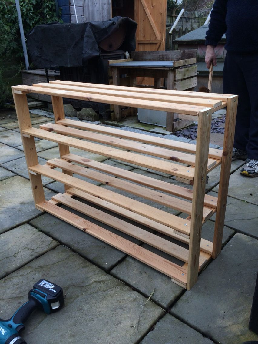 Shoe rack made out of old bed slats shoe rack for What to make out of those old wood pallets