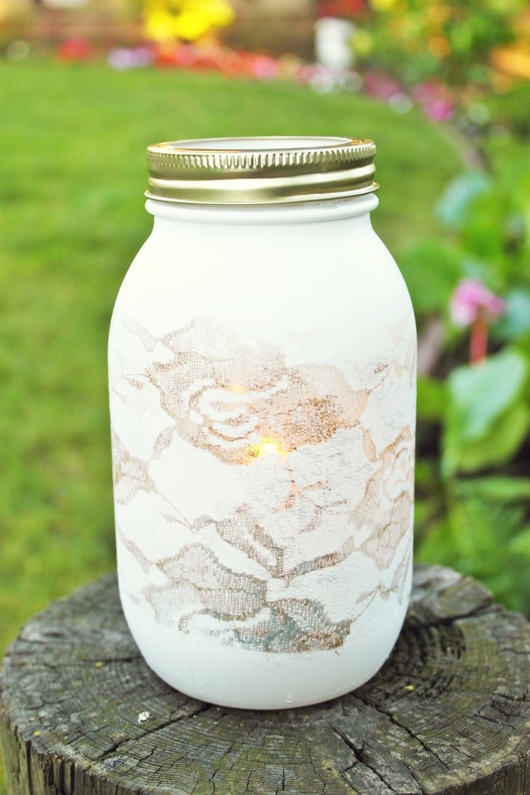 D.I.Y. lace spray painted vase. Very cute table decoration for a ...