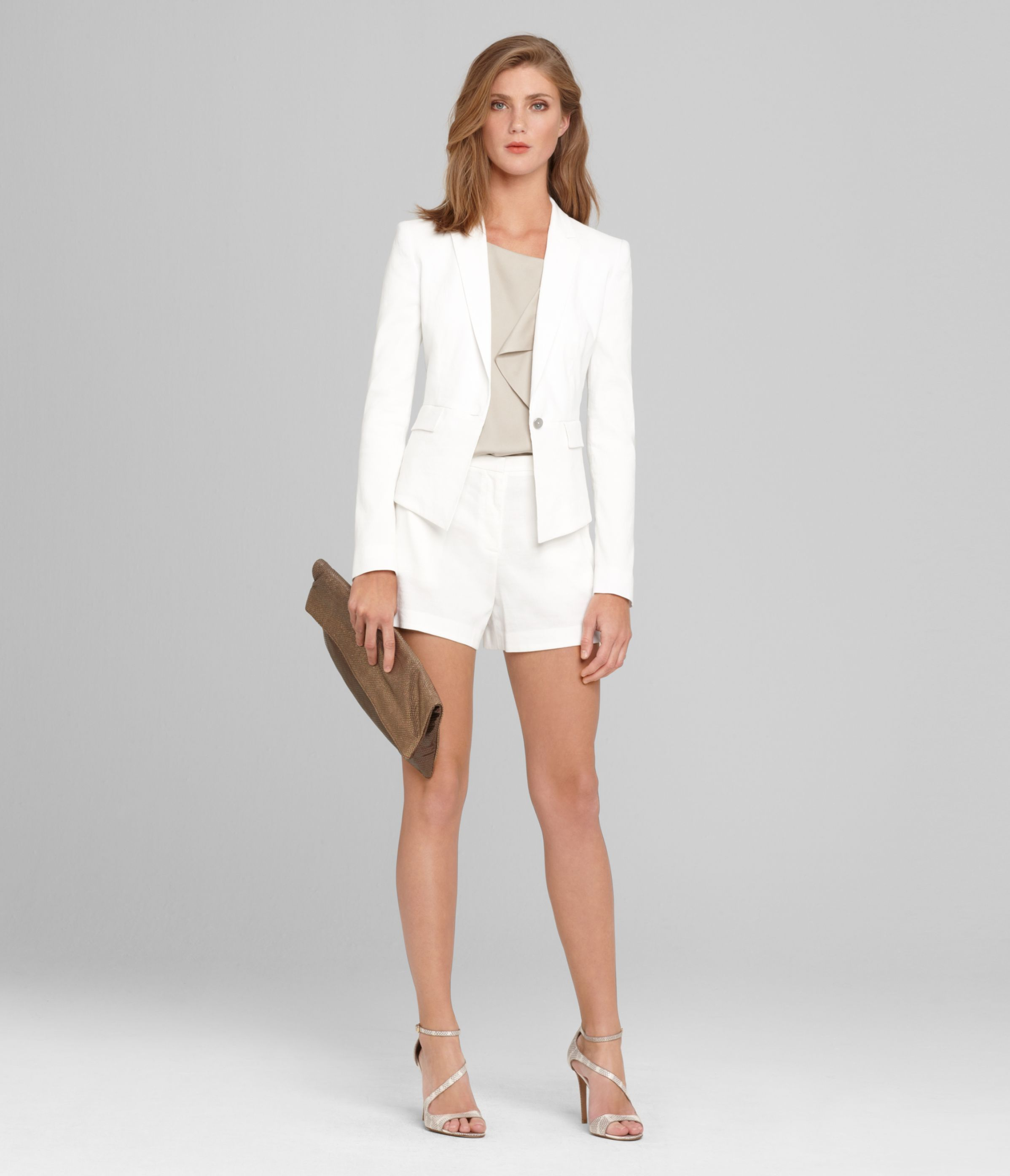 Crisp white short suit. This is a head turner for the ...