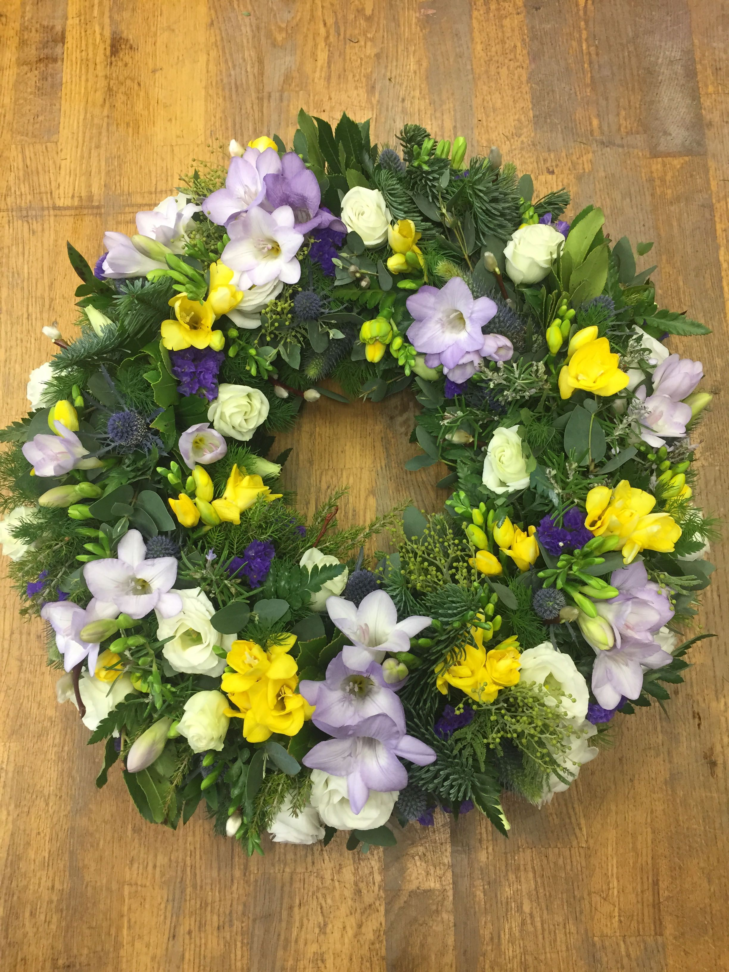 One of our beautiful classic wreaths styled in spring colours http need help selecting flowers for funeral funeral tributes are the perfect way to express emotions order funeral flowers online with us today izmirmasajfo