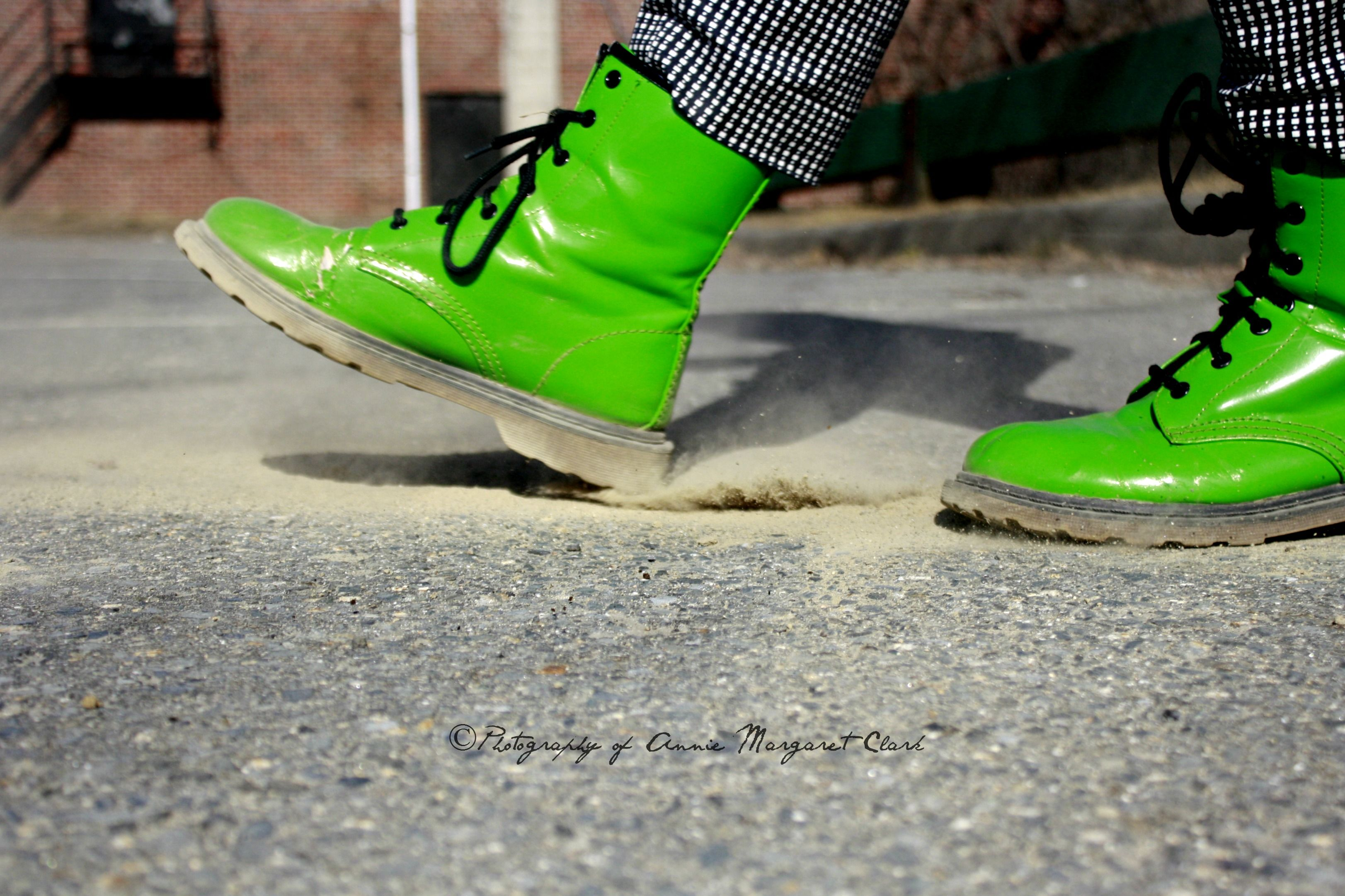 green boots in dust
