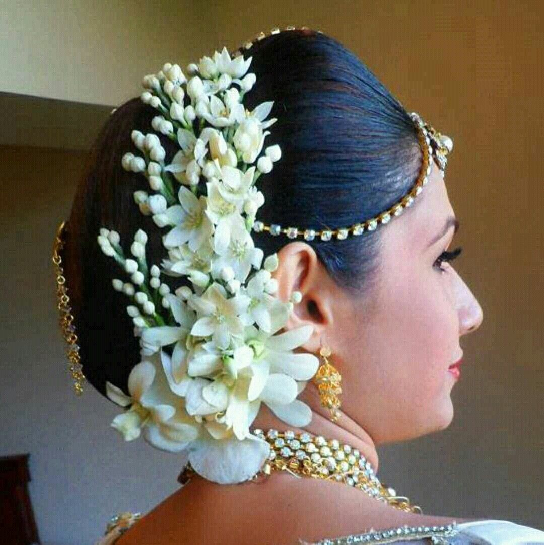 23 Evergreen Romantic Bridal Hairstyles: What A Beautiful Large Low Bun With Real Flower Gajra