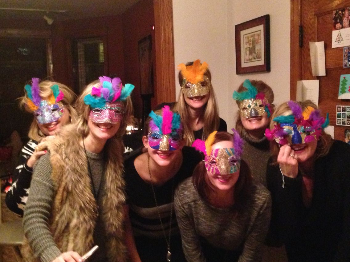 Mardi Gras masks at home! Purchased some plastic masks, glitter, feathers, glue, ect from Joann Fabrics and invited the ladies over for a Mardi Gras dinner, wine (of corse), and mask making!
