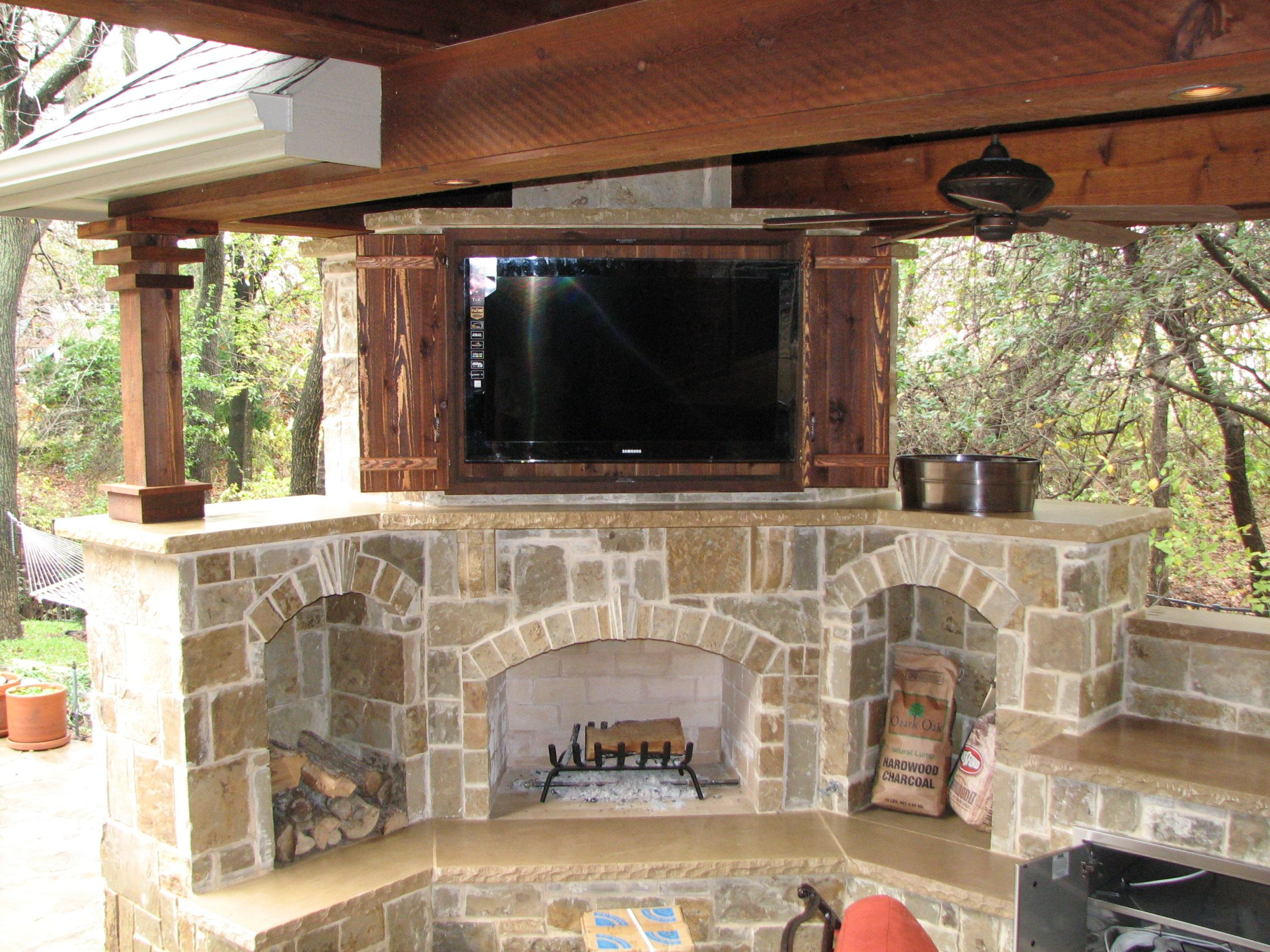 Antique Double Sliding Door Outdoor Tv Cabinet Over Rustic Stacked Stone Fireplace And Wooden Ceiling Pillar Exposed For Decorate Patio Terrace Decorating Ideas