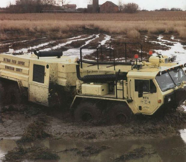 Oshkosh Da 1500 Articulated Military Fire Truck In The Mud Fire Trucks Cool Truck Accessories Tanks Military