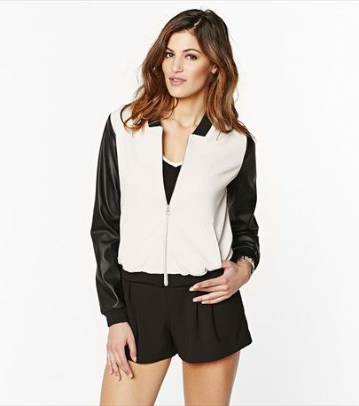 This lightweight soft bomber jacket features edgy faux leather sleeves! Perfect for transitioning into spring!