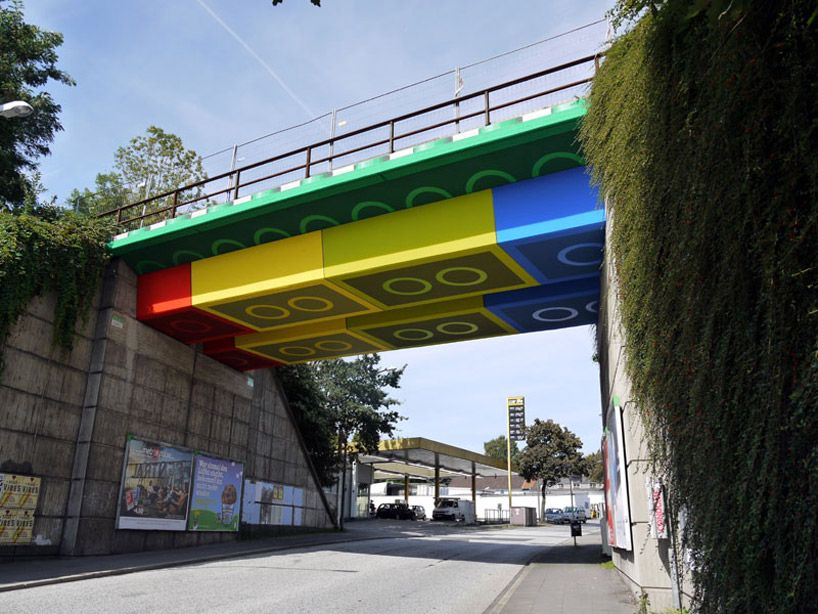 german artist megx (martin heuwold), has transformed a train overpass in wuppertal, germany by painting it to  seem as if the bridge were constructed of LEGO blocks.