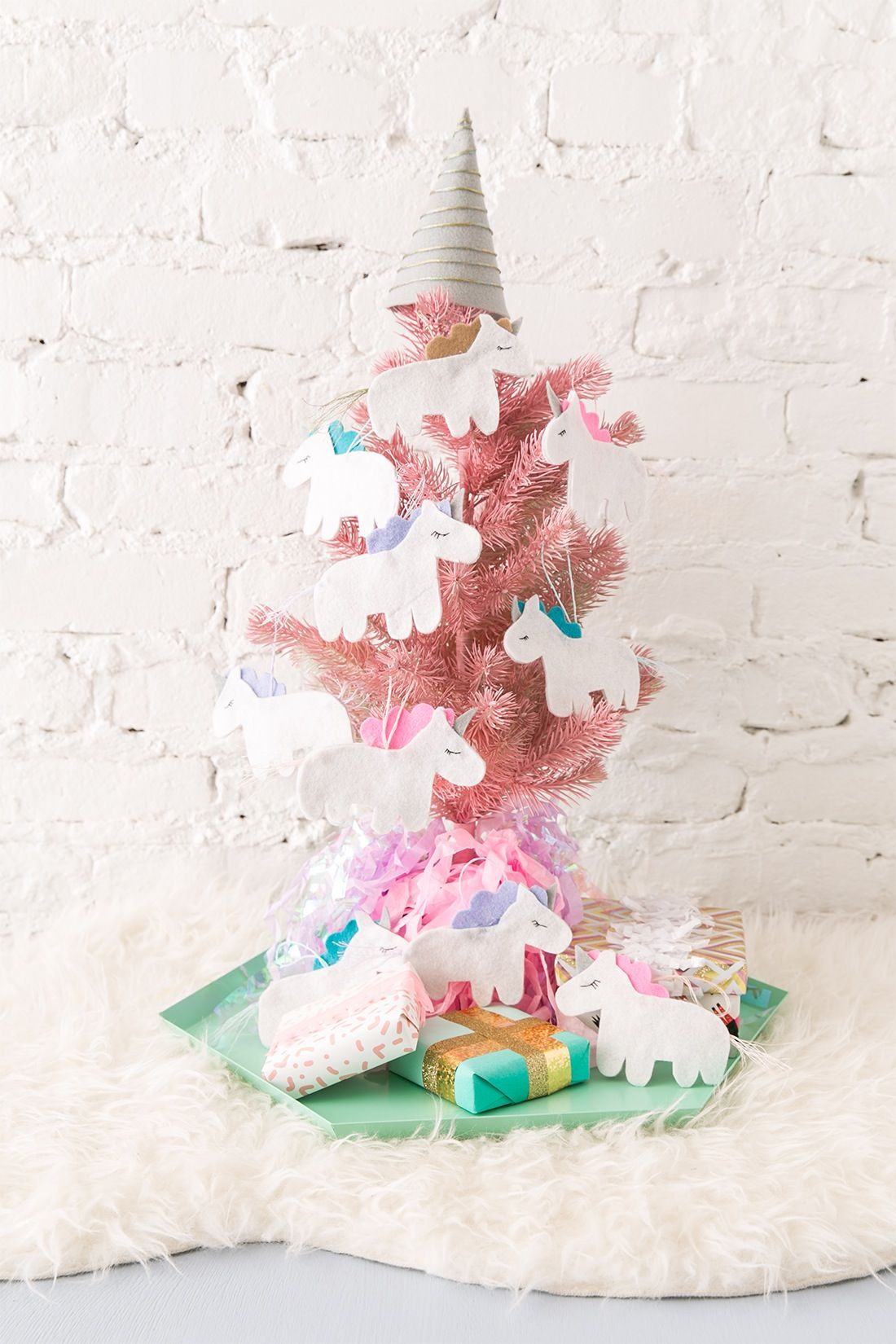 switch up your traditional holiday decor with this magical diy unicorn christmas tree - Unicorn Christmas Decorations
