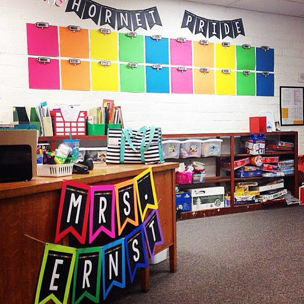 Classroom Design Colors ~ I love the clipboards on wall in bright colors