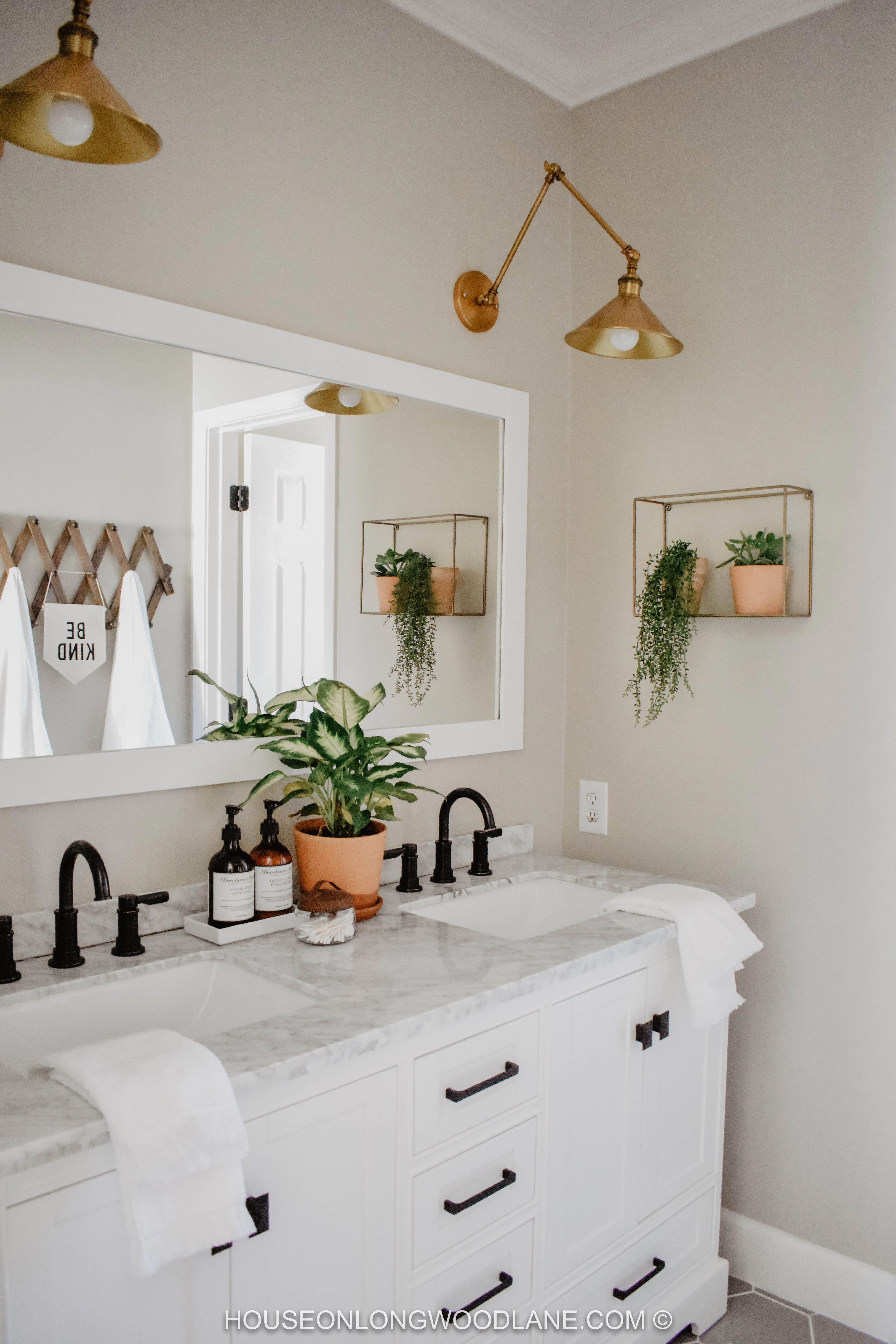 White And Neutral Bathroom With Copper Accents And A Charming Black Faucet Love The Plants And Small Detail Modern Boho Bathroom Home Remodeling Boho Bathroom