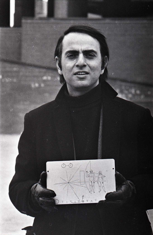 Carl sagan holding a copy of the plaque that flew with the pioneer space probes in boston - Jeff albertson ...