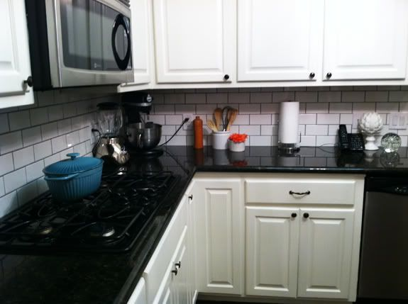 white subway tile black grout kitchen |  my favorite kitchens