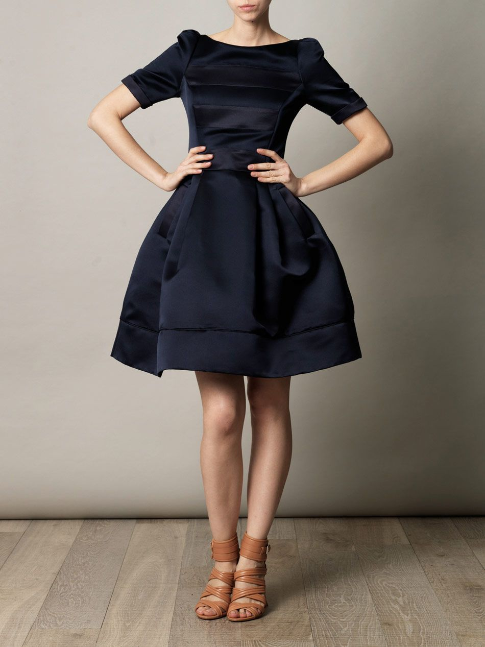 With all the timeless grandeur of vintage couture comes this full-skirted dress from British label Suzannah.