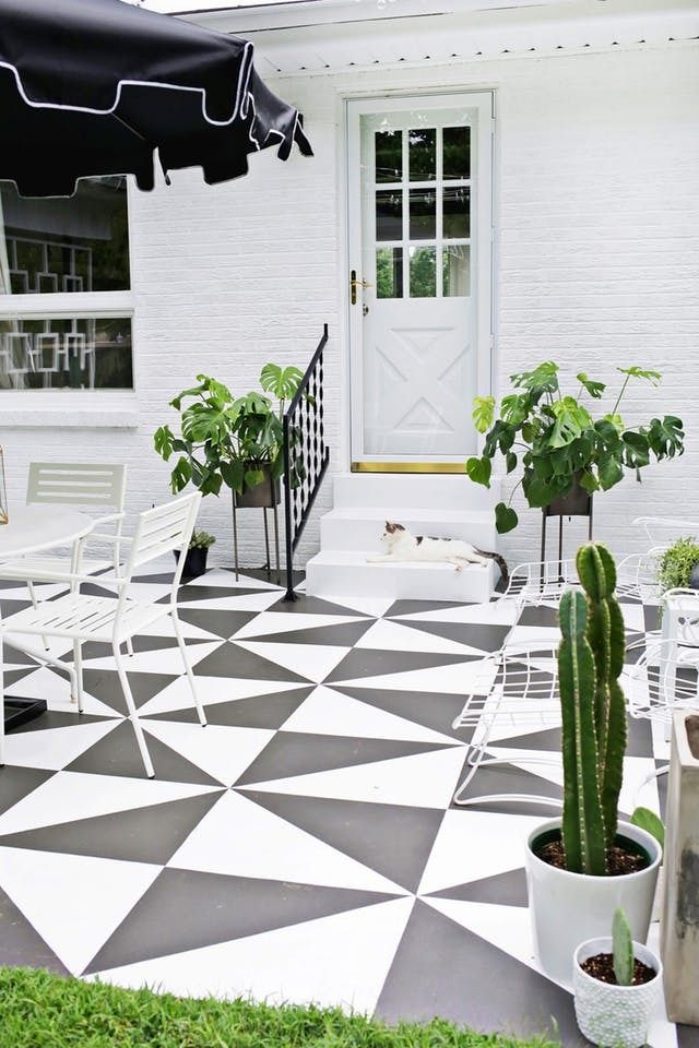 A Little Paint Is All It Takes To Totally Transform Your Patio Paint Concrete Patio Painted Patio Patio Tiles