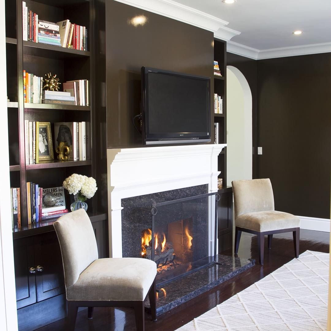 Cold Cali days make me dream of an inviting fireplace #moodyden #chocolatelacquer #dreamyinteriors #seyiedesign