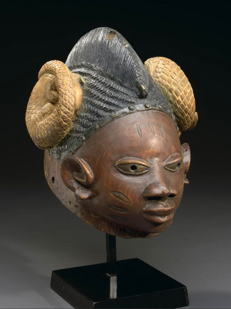 Africa | Gelede helmet mask from the Yoruba people of Nigeria | Wood and pigment