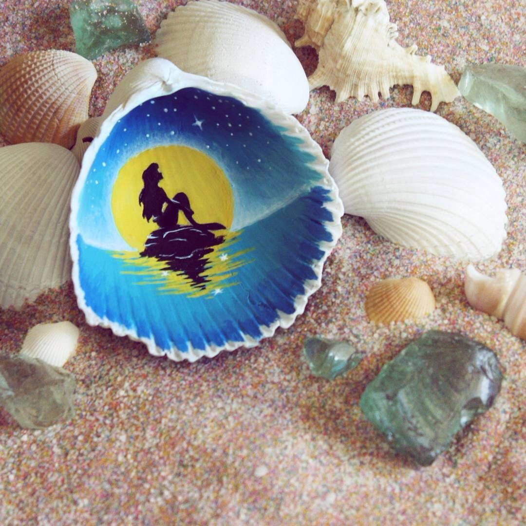 The Little Mermaid Silhouette Painted Onto A Shell