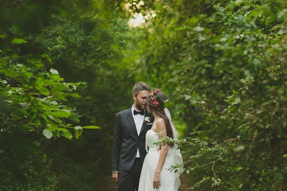 """Music festival lovers Cris and Vlad wanted their Romanian wedding to reflect their love of going to, and playing at them. """"The inspiration for our wedding was music festivals, Woodstock in particular"""", said the bride. """"My husband proposed at Sziget Festival, in a tent, at 3 am and I am in a band so it made perfect sense."""""""