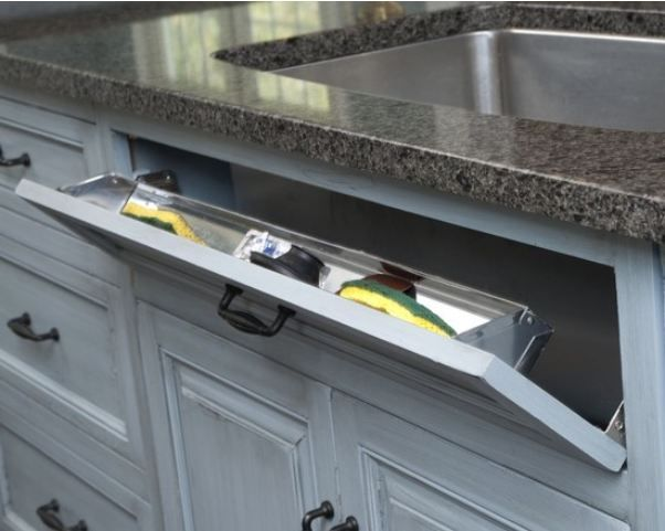 Pop out kitchen sink drawer for sponges, etc. From houzz.com ...