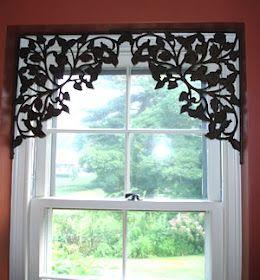 Use antique ornate shelf brackets in upper corners of a window or doorway...dining room window