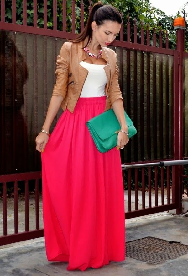 pink skirt leather jacket with white blouse and green purse