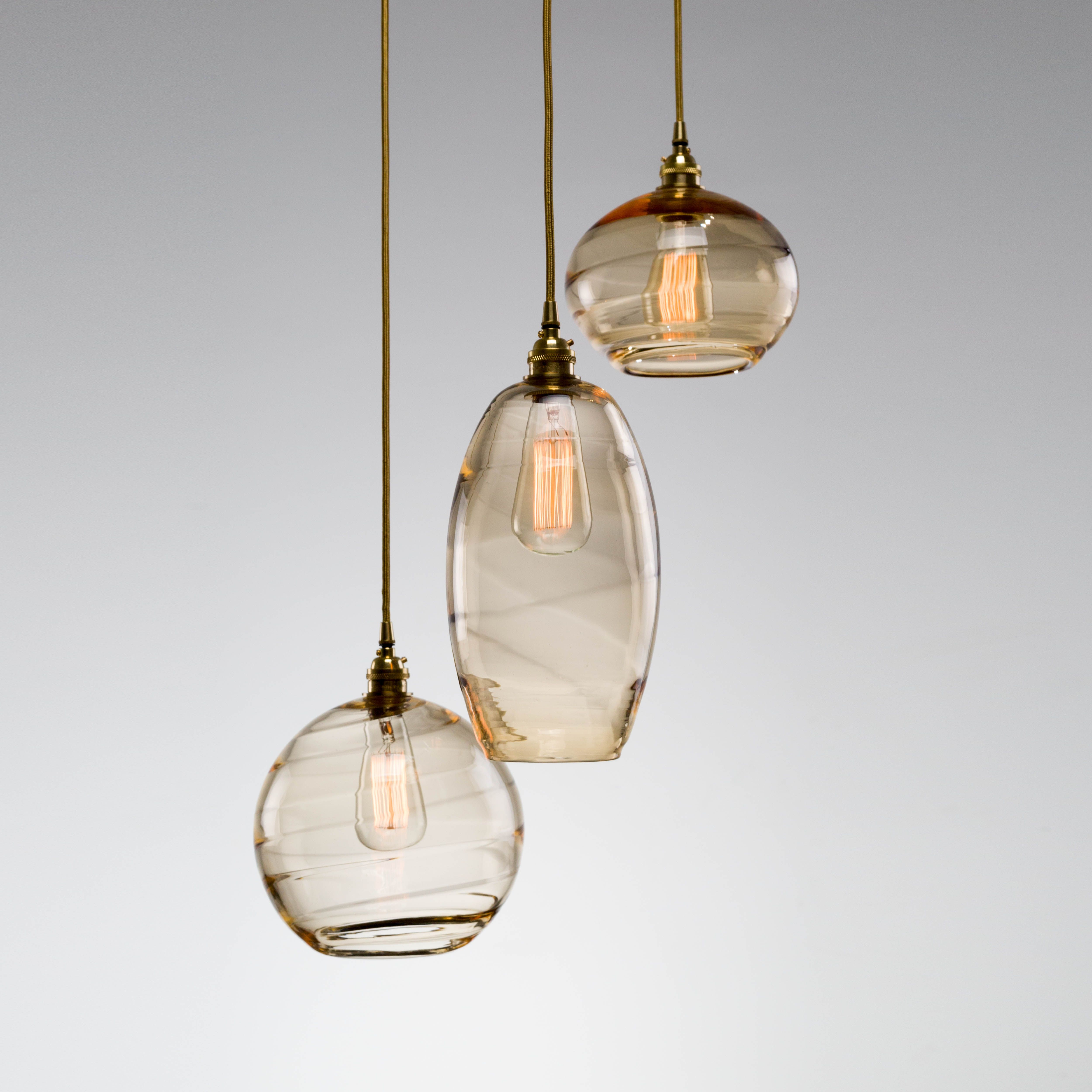 This Multi Port Chandelier Combines Three Optic Blown Glass Styles Under One Canopy S Hand Blown Glass Lighting Blown Glass Lighting Blown Glass Pendant Light