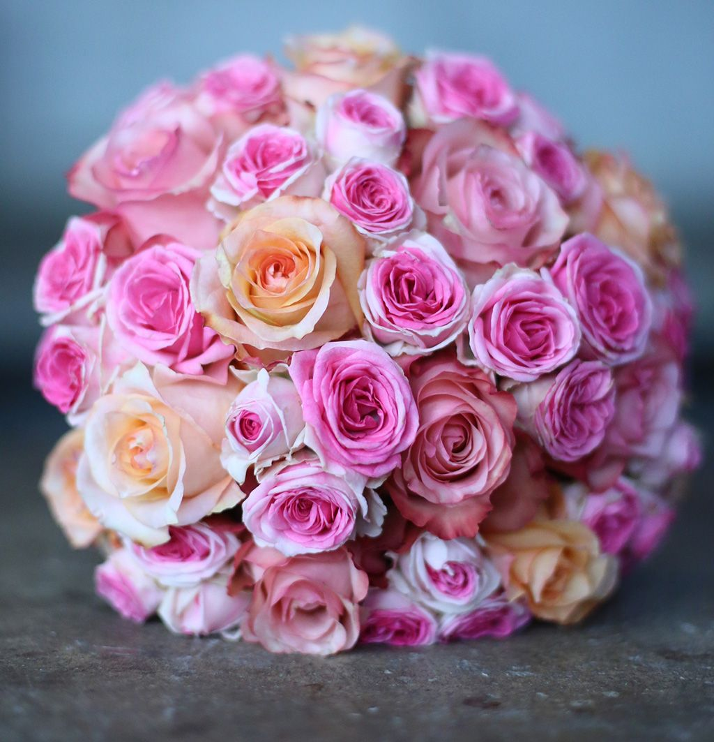 A gorgeous, hand-tied bridal bouquet created with premium pink and ...