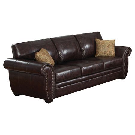 Faux leather sofa with a wood frame and nailhead trim Product