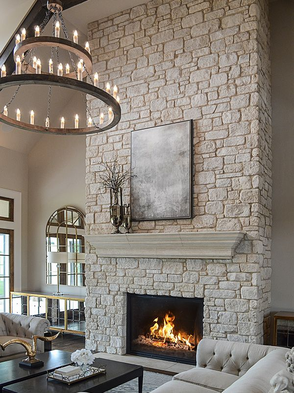 what a stunning fireplace and stone mantle this cream colored