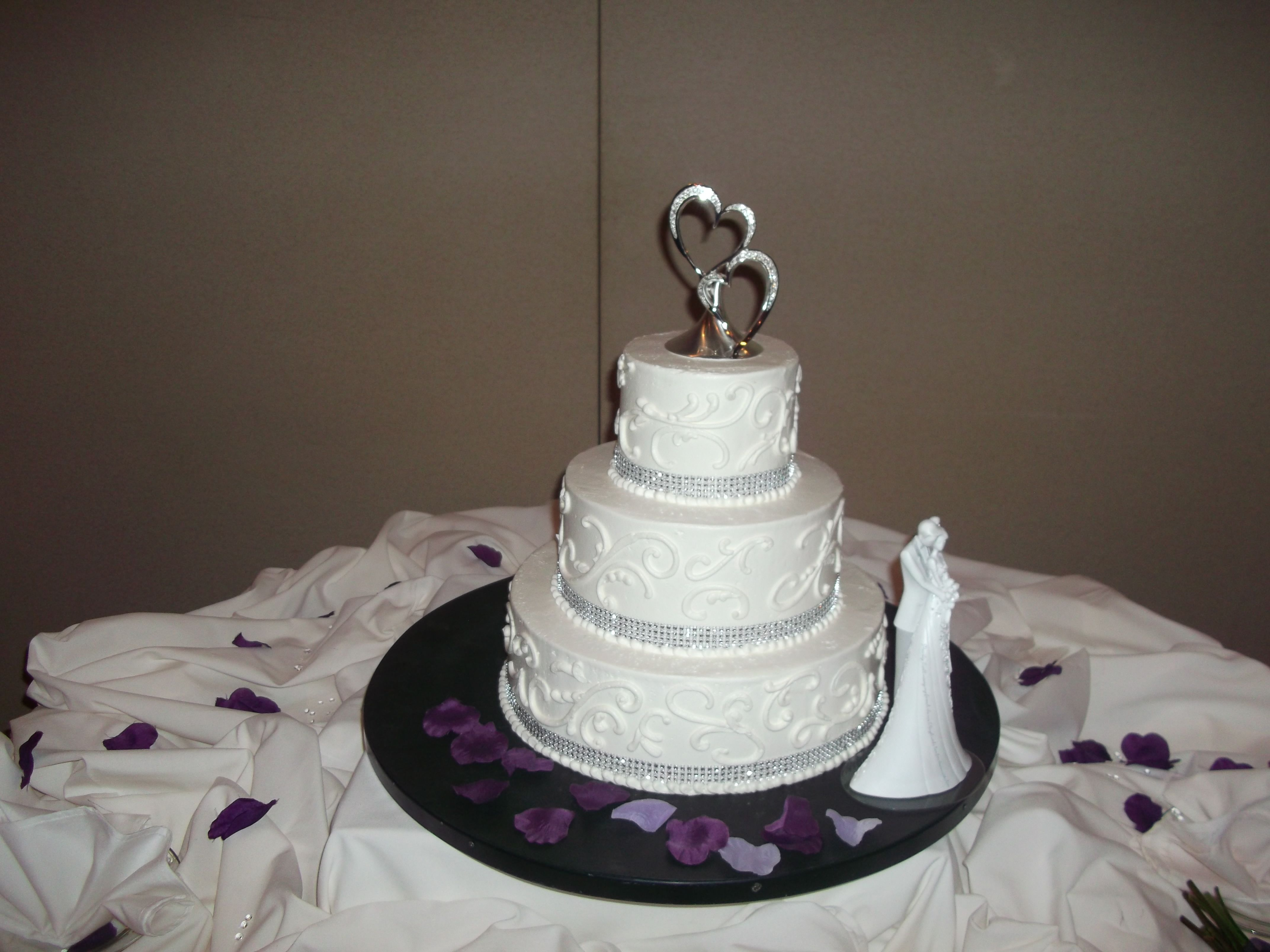 White with crystals tiered white buttercream wedding cake with