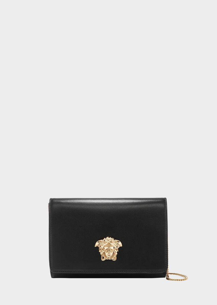 ef3335dade2c Medusa Head Evening Clutch Bag from Versace Women s Collection. Clutch bag  crafted in calf leather