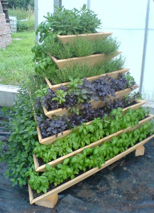 Small Space Vegetable Gardening Ideas pots with herbs planted in a patio vegetable garden The Dirty Dozen 12 Vertical Gardening Ideas For Diy Gardeners