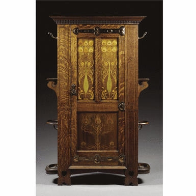 An Arts and Crafts oak and inlaid hall cupboard by Shapland & Petter of Barnstaple , circa 1900 - Sotheby's