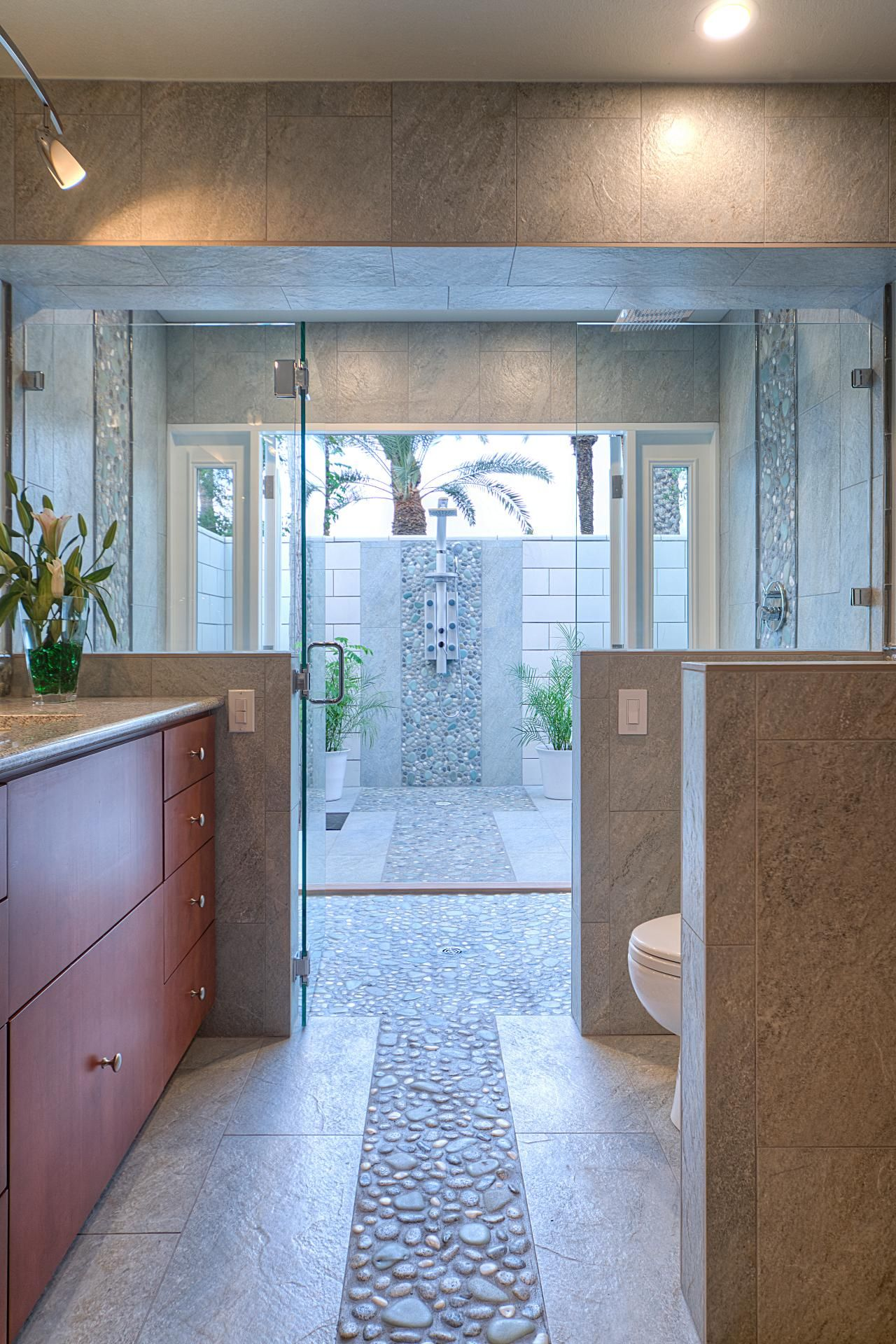 This breathtaking bathroom features a large, open-air shower. French ...