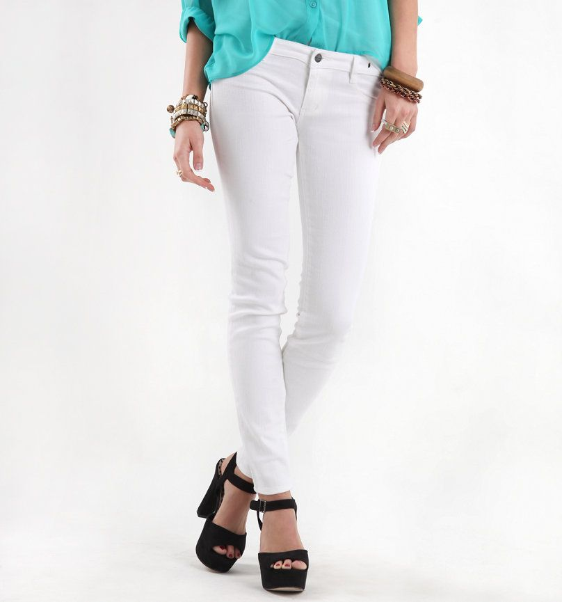 Turquoise, white jeans, and black clunky heals