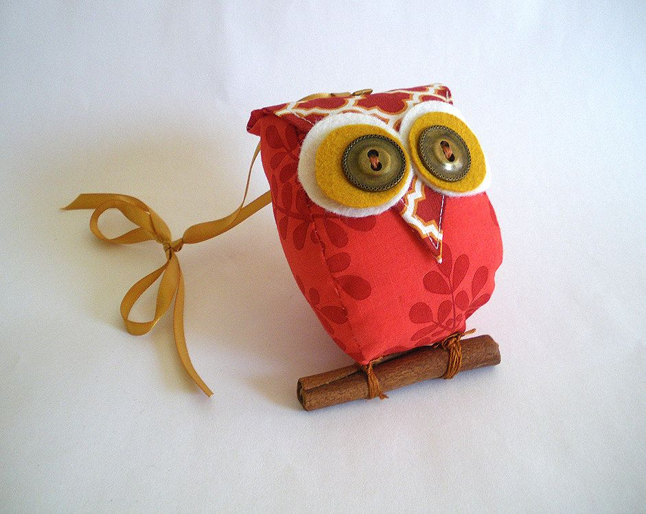 red owl with cinnamon stick branch (With images