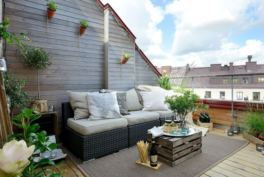 Modern Furniture Designs with Fancy Eyes Catching: Lovely Gothenburg Apartment  Terrace With Wooden Box Wooden Floor Grey Carpet Rattan Sofa .