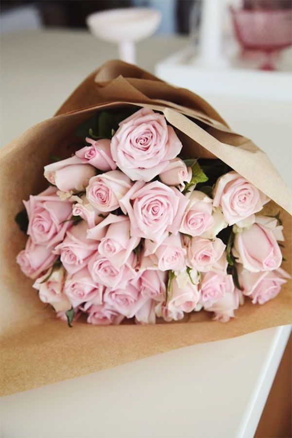 Light Pink Roses Wrapped In Kraft Paper In 2020 Light Pink Rose Pink Roses Beautiful Flowers