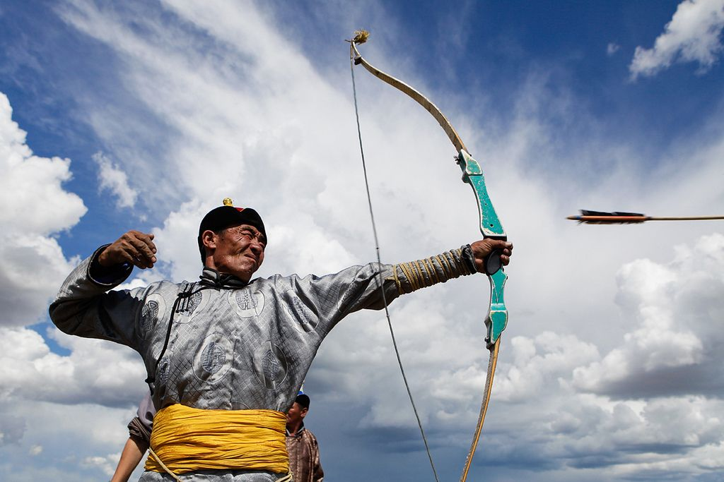 An archer lets loose his arrow in a preliminary round of the archery competition of Nadaam in Ondorkhaan in Mongolia. Nadaam means Games in english, and it is the most important celebration of the year in Mongolia. It lasts from 2-3 days depending on how large the town is, and features competitions in archery, wrestling, and horse racing. Photo by Elijah Nouvelage