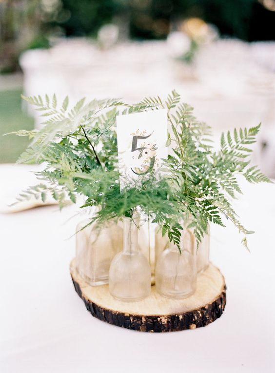 Evergreens In Glass Tubes On A Wood Slice For A Simple Green Centerpiece Fern Wedding Round Wedding Tables Wedding Table Centerpieces