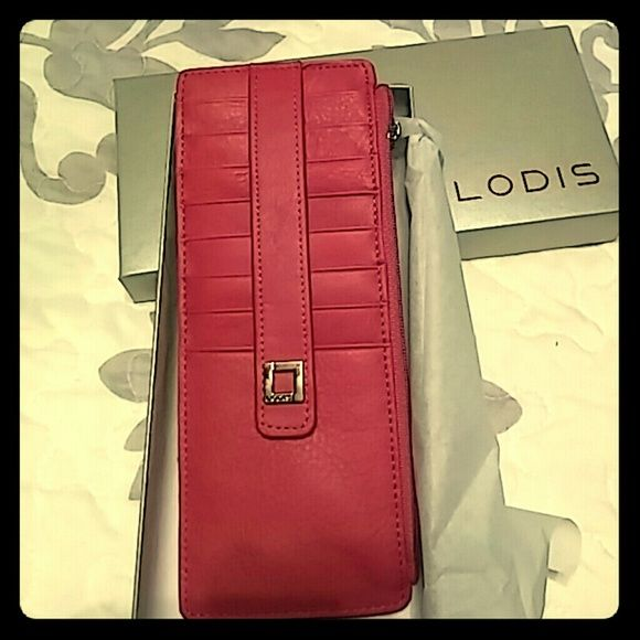 *Memorial Weekend Sale* LODIS w/ RFID Protection This is a gorgeous soft leather card case/ wallet by Lodis in a gorgeous pink fuchsia color. It holds 8 cards securely with the RFID protecting & a snap closure, id slip pocket on other side with a coin/ money zipper. Silver hardware. So soft like butter leather. Perfect for smaller bags or just to keep your cards separate and protected. The bright pink color makes it easy to find in big bags! Measures 7x3, brand new in gift box. Lodis Bags…