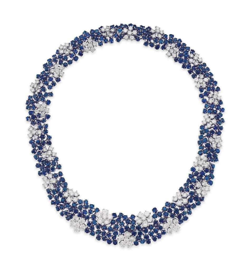 A SAPPHIRE AND DIAMOND NECKLACE Designed as a circularcut sapphire