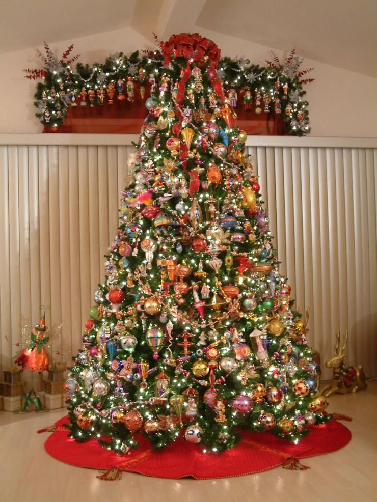 a ten foot tall christmas tree filled with christopher radko collectible glass disney ornaments - 10 Foot Christmas Tree
