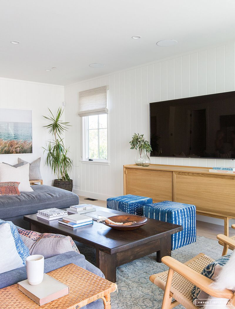 Grey and blue living room with warm woods // a TV worked into a ...