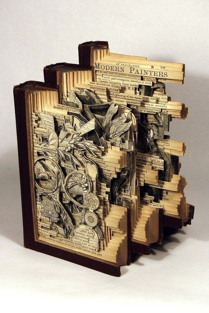 "Art with books. It's amazing.....but part of me is saying ""NO! You hurt the poor books..... :("" Still. Cool!"