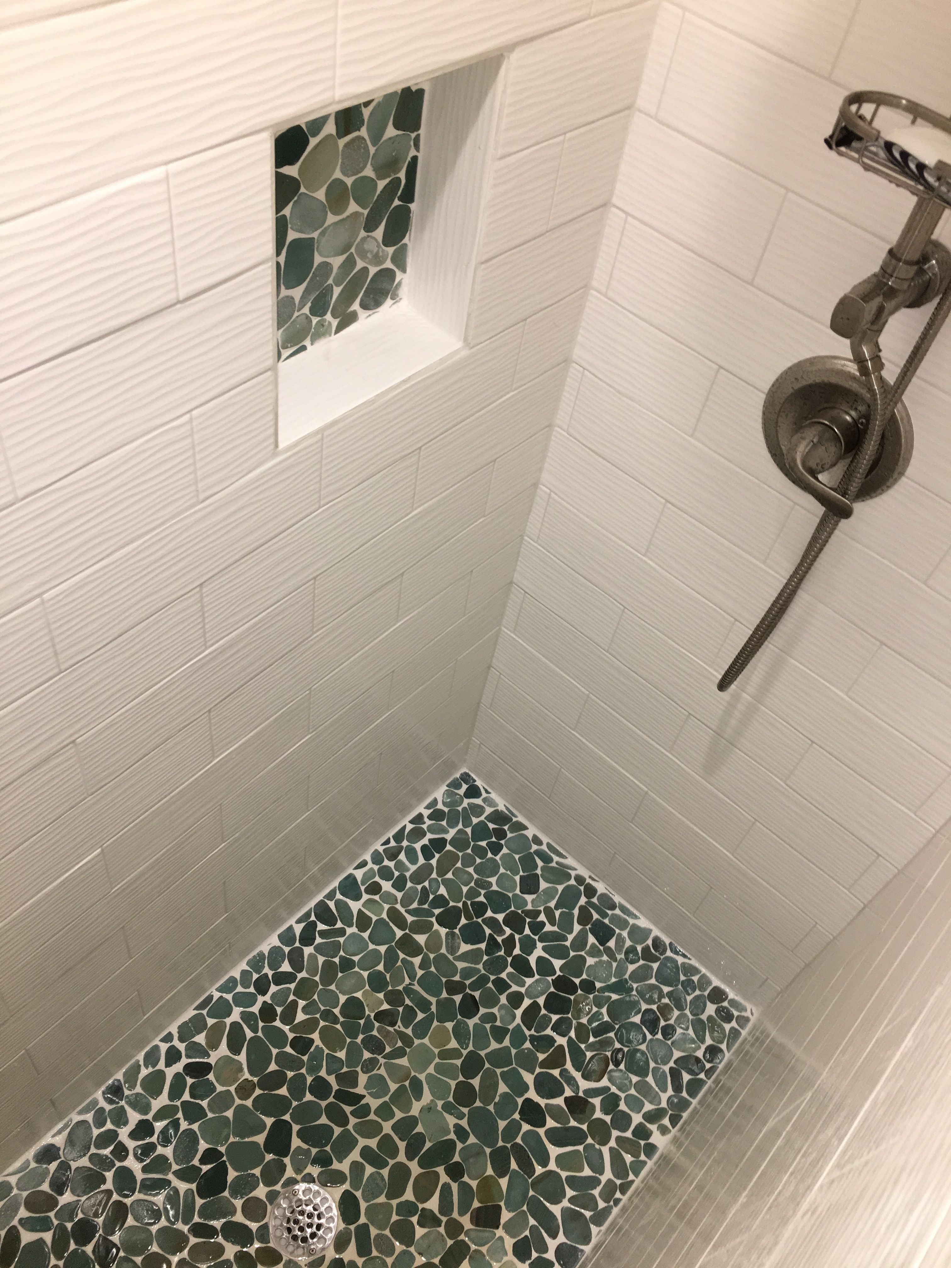 Gorgeous Pop Of Color On The Shower Floor And In The Niche Using Sliced Sea Green Pebble Tile Https Www Pebbl Shower Floor Shower Tile Bathroom Shower Walls