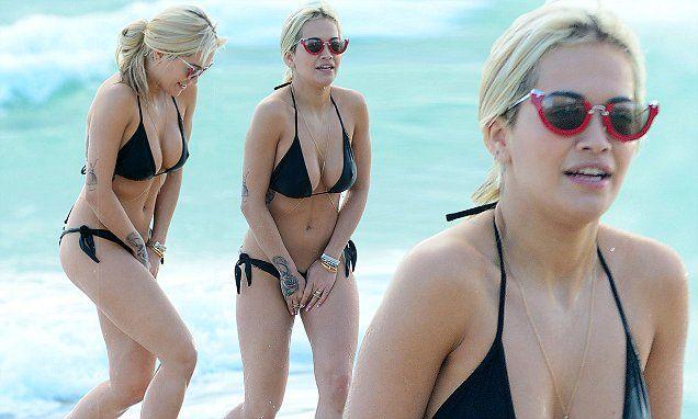 Rita Ora avoids wardrobe malfunction in black bikini on ...